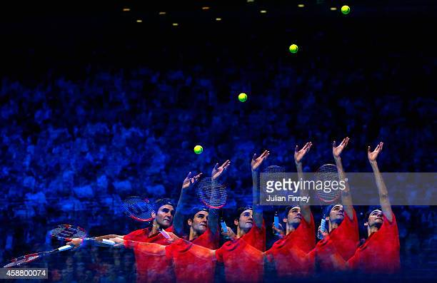 Roger Federer of Switzerland serves in the round robin singles match against Kei Nishikori of Japan on day three of the Barclays ATP World Tour...