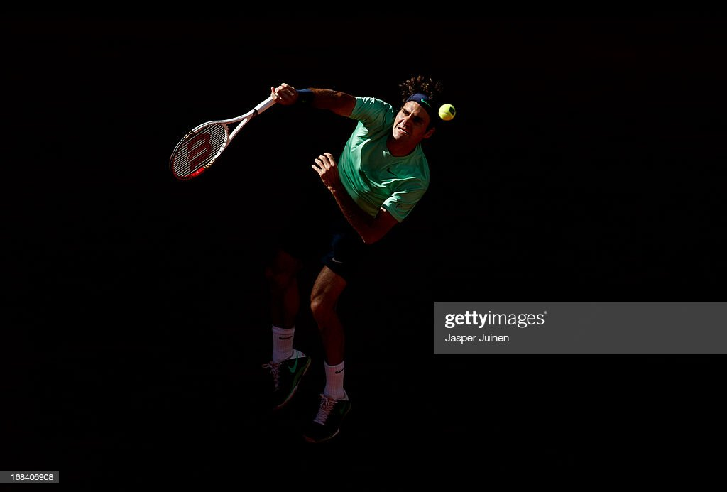 Roger Federer of Switzerland serves the ball during his match against Kei Nishikori of Japan on day six of the Mutua Madrid Open tennis tournament at the Caja Magica on May 9, 2013 in Madrid, Spain.