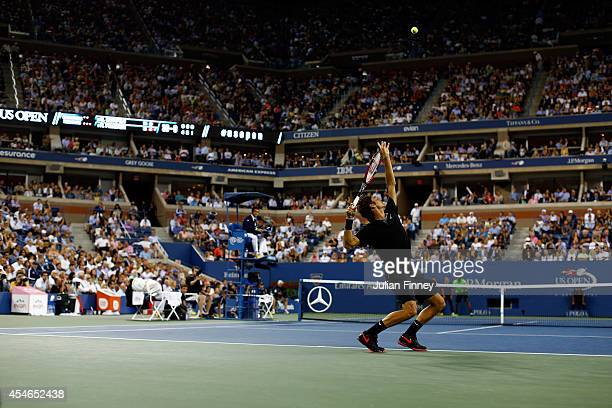 Roger Federer of Switzerland serves to Gael Monfils of France during their men's singles quarterfinal match on Day Eleven of the 2014 US Open at the...