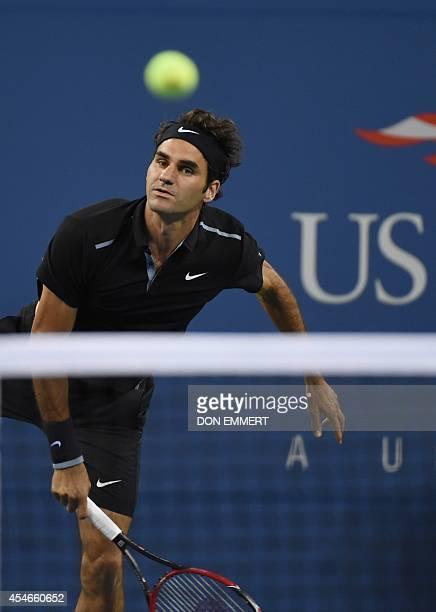 Roger Federer of Switzerland serves to Gael Monfils of France during their US Open 2014 men's singles quarterfinals match at the USTA Billie Jean...