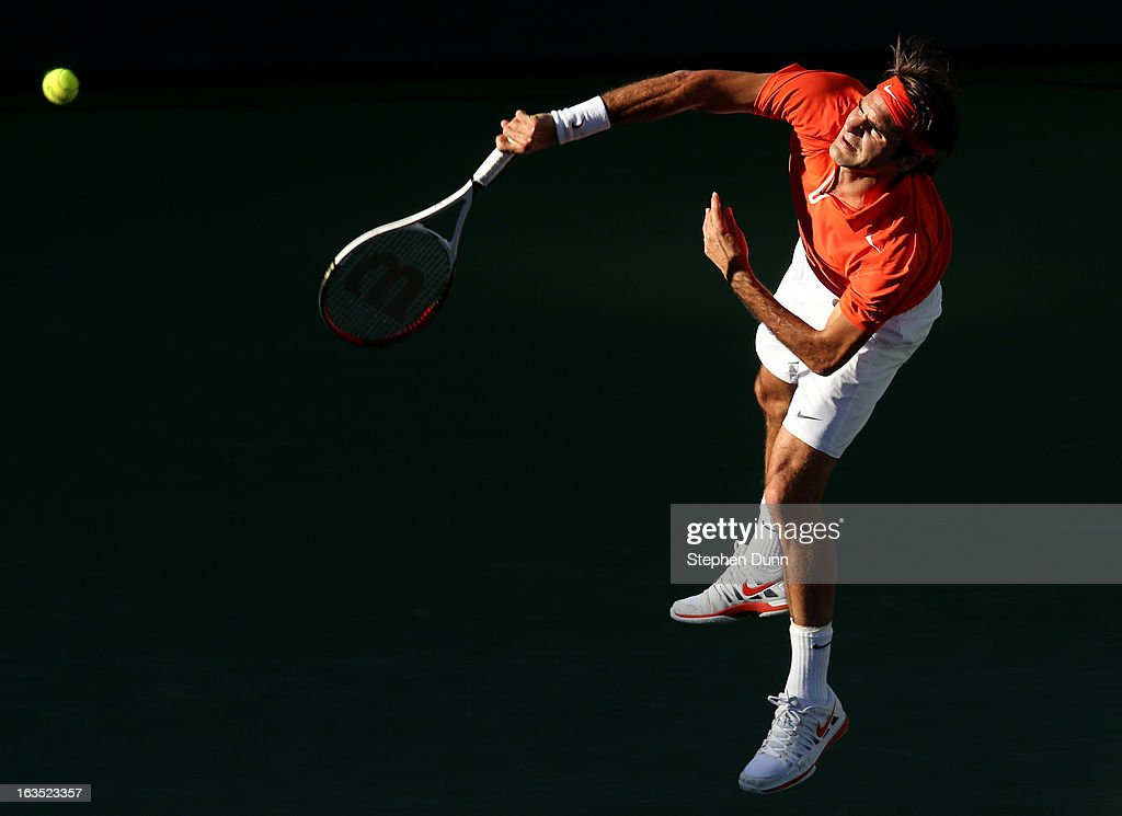 Roger Federer of Switzerland serves to Ivan Dodig of Croatia during day 6 of the BNP Paribas Open at Indian Wells Tennis Garden on March 11, 2013 in Indian Wells, California. (Photo by Stephen Dunn/Getty Images).