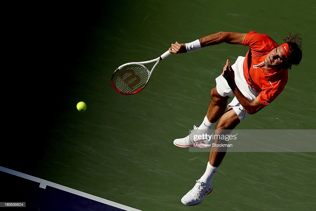 Roger Federer of Switzerland serves to Ivan Dodig of Croatia during the BNP Paribas Open at the Indian Wells Tennis Garden on March 11, 2013 in Indian Wells, California.