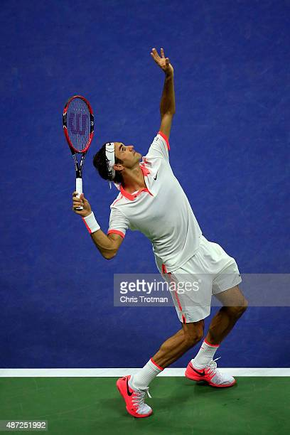 Roger Federer of Switzerland serves to John Isner of the United States during their Men's Singles Fourth Round match on Day Eight of the 2015 US Open...