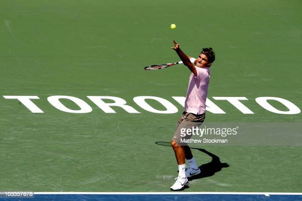 Roger Federer of Switzerland serves to Michael Llodra of France during the Rogers Cup at the Rexall Centre on August 12 2010 in Toronto Canada
