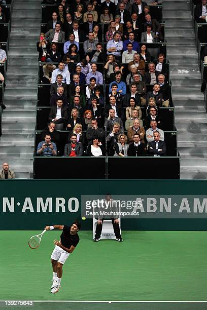 Roger Federer of Switzerland serves to Nikolay Davydenko of Russia in the semi final on day 6 of the ABN AMRO World Tennis Tournament on February 18...