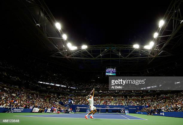 Roger Federer of Switzerland serves to Novak Djokovic of Serbia during their Men's Singles Final match on Day Fourteen of the 2015 US Open at the...