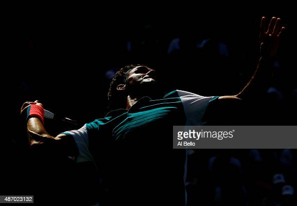 Roger Federer of Switzerland serves to Philipp Kohlschreiber of Germany during their Men's Singles Third Round match on Day Six of the 2015 US Open...