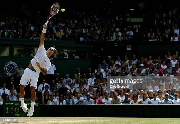 Roger Federer of Switzerland serves to Rafael Nadal of Spain during the men's final on day thirteen of the Wimbledon Lawn Tennis Championships at the...