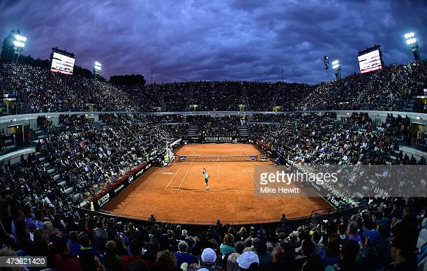 Roger Federer of Switzerland serves under the Rome lights during his Men's Semi Final against compatriot Stan Wawrinka on Day Seven of The...