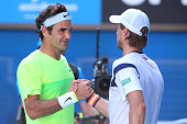 Roger Federer of Switzerland shakes hands with Andreas Seppi of Italy after Federer lost their third round match against during day five of the 2015...