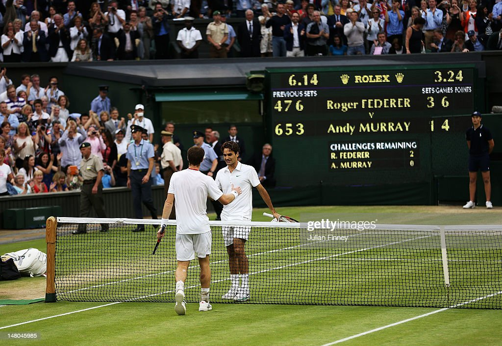 Roger Federer of Switzerland (R) shakes hands with Andy Murray of Great Britain after defeating him during their Gentlemen's Singles final match on day thirteen of the Wimbledon Lawn Tennis Championships at the All England Lawn Tennis and Croquet Club on July 8, 2012 in London, England.