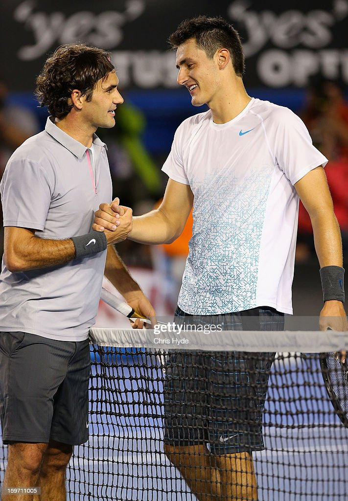 Roger Federer of Switzerland shakes hands with Bernard Tomic of Australia after their third round match during day six of the 2013 Australian Open at Melbourne Park on January 19, 2013 in Melbourne, Australia.