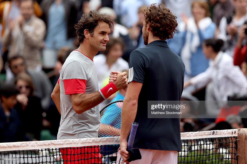 <a gi-track='captionPersonalityLinkClicked' href=/galleries/search?phrase=Roger+Federer&family=editorial&specificpeople=157480 ng-click='$event.stopPropagation()'>Roger Federer</a> of Switzerland shakes hands with <a gi-track='captionPersonalityLinkClicked' href=/galleries/search?phrase=Ernests+Gulbis&family=editorial&specificpeople=4095282 ng-click='$event.stopPropagation()'>Ernests Gulbis</a> of Latvia at the net following his defeat in their men's singles match on day eight of the French Open at Roland Garros on June 1, 2014 in Paris, France.