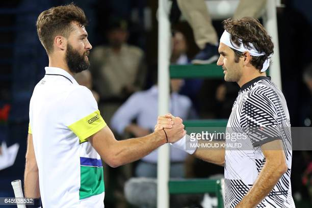 Roger Federer of Switzerland shakes hands with France's Benoit Paire after winning their ATP tennis match during the Dubai Duty Free Championships on...
