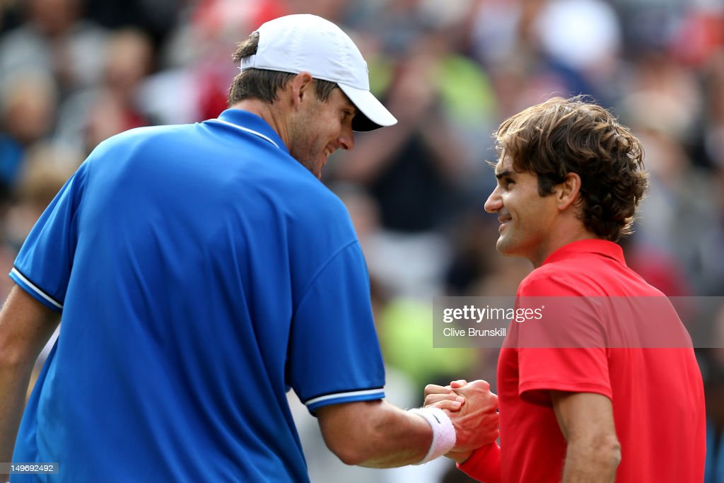 <a gi-track='captionPersonalityLinkClicked' href=/galleries/search?phrase=Roger+Federer&family=editorial&specificpeople=157480 ng-click='$event.stopPropagation()'>Roger Federer</a> (R) of Switzerland shakes hands with <a gi-track='captionPersonalityLinkClicked' href=/galleries/search?phrase=John+Isner+-+Tennis+Player&family=editorial&specificpeople=4439464 ng-click='$event.stopPropagation()'>John Isner</a> (L) of the United States after defeating him in the Quarterfinal of Men's Singles Tennis on Day 6 of the London 2012 Olympic Games at Wimbledon on August 2, 2012 in London, England.