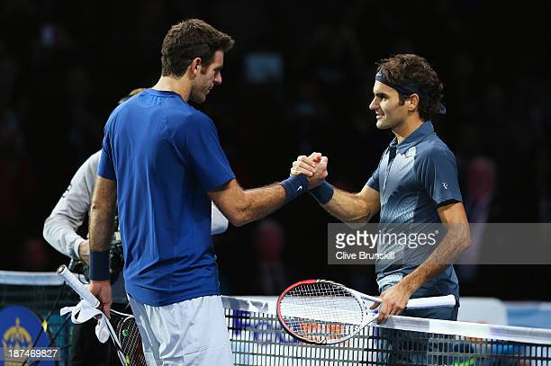 Roger Federer of Switzerland shakes hands with Juan Martin Del Potro of Argentina after Federer won the match during day six of the Barclays ATP...