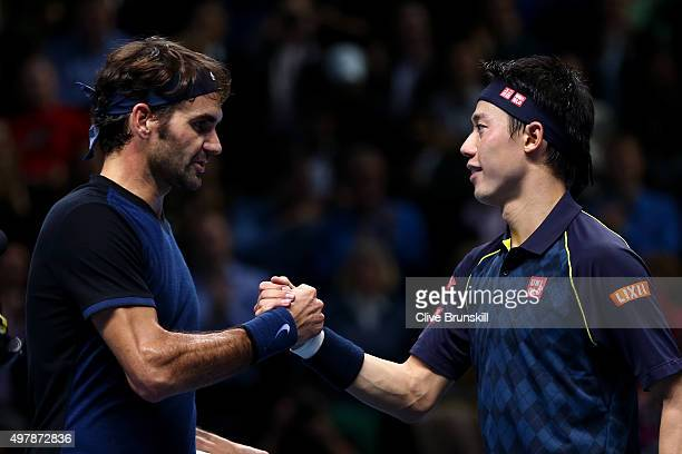 Roger Federer of Switzerland shakes hands with Kei Nishikori of Japan after his victory in their men's singles match on day five of the Barclays ATP...