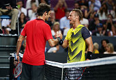 Roger Federer of Switzerland shakes hands with Lleyton Hewitt of Australia after their match at Qantas Credit Union Arena on January 12 2015 in...