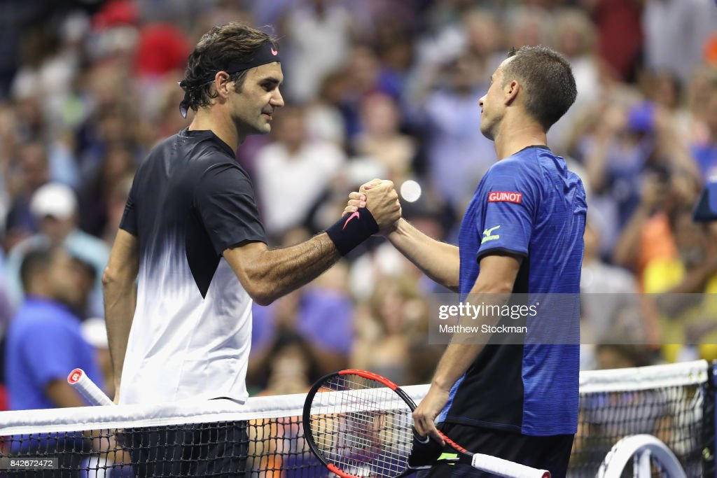 Roger Federer of Switzerland shakes hands with Philipp Kohlschreiber of Germany after defeating him in their men's singles fourth round match on Day Eight of the 2017 US Open at the USTA Billie Jean King National Tennis Center on September 4, 2017 in the Flushing neighborhood of the Queens borough of New York City.
