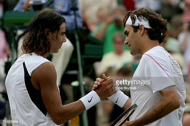 Roger Federer of Switzerland shakes hands with Rafael Nadal of Spain after winning the men's final on day thirteen of the Wimbledon Lawn Tennis...