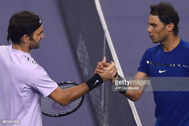 Roger Federer of Switzerland shakes hands with Rafael Nadal of Spain after their men's singles final match at the Shanghai Masters tennis tournament...