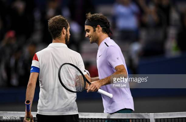 Roger Federer of Switzerland shakes hands with Richard Gasquet of France the match against on Day 6 during Men's Single QuaterFinal of 2017 ATP 1000...