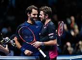 Roger Federer of Switzerland shakes hands with Stanislas Wawrinka of Switzerland after his victory in their men's semi final on day seven of the...