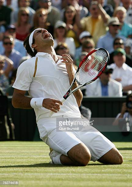 Roger Federer of Switzerland shows his emotions as he celebrates victory following the Men's Singles final match against Rafael Nadal of Spain during...