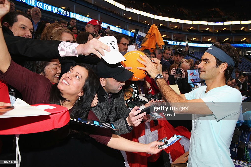 Roger Federer of Switzerland signs autographs for fans prior to his men's singles semi-final match against Rafael Nadal of Spain during day seven of the Barclays ATP World Tour Finals at O2 Arena on November 10, 2013 in London, England.