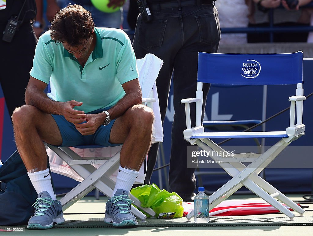 <a gi-track='captionPersonalityLinkClicked' href=/galleries/search?phrase=Roger+Federer&family=editorial&specificpeople=157480 ng-click='$event.stopPropagation()'>Roger Federer</a> of Switzerland sits in his chair after his loss to Jo-Wilfried Tsonga of France in the finals match during Rogers Cup at Rexall Centre at York University on August 10, 2014 in Toronto, Canada.