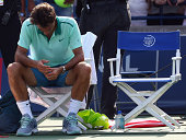 Roger Federer of Switzerland sits in his chair after his loss to JoWilfried Tsonga of France in the finals match during Rogers Cup at Rexall Centre...