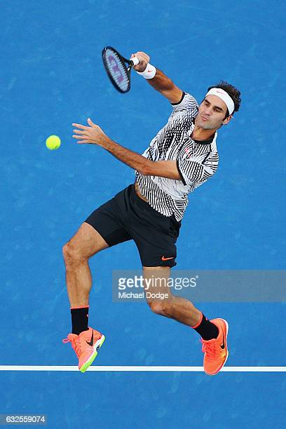 Roger Federer of Switzerland smashes a lob his quarterfinal match against Mischa Zverev of Germany day nine of the 2017 Australian Open at Melbourne...