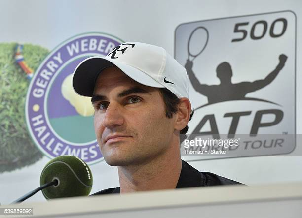 Roger Federer of Switzerland smiles at the press conference after his arrival during day one of the Gerry Weber Open at Gerry Weber Stadium on June...