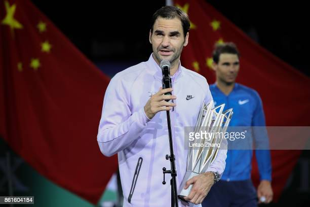 Roger Federer of Switzerland speak during the award ceremony after win his Men's singles final match against Rafael Nadal of Spain reacts on day...