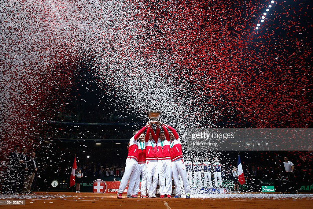<a gi-track='captionPersonalityLinkClicked' href=/galleries/search?phrase=Roger+Federer&family=editorial&specificpeople=157480 ng-click='$event.stopPropagation()'>Roger Federer</a> of Switzerland, <a gi-track='captionPersonalityLinkClicked' href=/galleries/search?phrase=Stanislas+Wawrinka&family=editorial&specificpeople=557155 ng-click='$event.stopPropagation()'>Stanislas Wawrinka</a> of Switzerland , <a gi-track='captionPersonalityLinkClicked' href=/galleries/search?phrase=Marco+Chiudinelli&family=editorial&specificpeople=582736 ng-click='$event.stopPropagation()'>Marco Chiudinelli</a> of Switzerland, <a gi-track='captionPersonalityLinkClicked' href=/galleries/search?phrase=Michael+Lammer&family=editorial&specificpeople=553839 ng-click='$event.stopPropagation()'>Michael Lammer</a> of Switzerland and Captain Severin Luthi of Switzerland celebrate winning the Davis Cup against France during day three of the Davis Cup Tennis Final between France and Switzerland at the Stade Pierre Mauroy on November 23, 2014 in Lille, France.