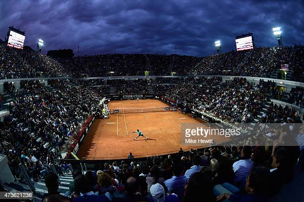 Roger Federer of Switzerland stretches for a backhand under the Rome lights during his Men's Semi Final against compatriot Stan Wawrinka on Day Seven...