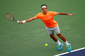 Roger Federer of Switzerland stretches for a forehand in his match against Novak Djokovic of Serbia in the final during day fourteen of the BNP...