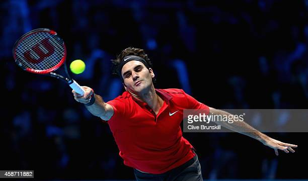 Roger Federer of Switzerland stretches to play a forehand against Milos Raonic of Canada during their round robin match during the Barclays ATP World...