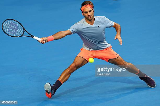 Roger Federer of Switzerland stretches to play a forehand to Alexander Zverev of Germany during the men's singles match on day four of the 2017...