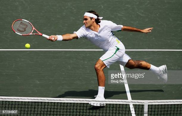 Roger Federer of Switzerland stretches to return a forehand to Ivan Ljubicic of Croatia during the men's final of the Nasdaq100 Open at the Tennis...