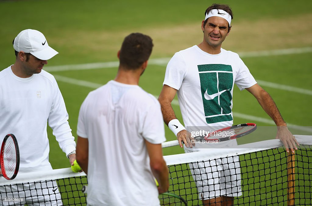<a gi-track='captionPersonalityLinkClicked' href=/galleries/search?phrase=Roger+Federer&family=editorial&specificpeople=157480 ng-click='$event.stopPropagation()'>Roger Federer</a> of Switzerland talks to <a gi-track='captionPersonalityLinkClicked' href=/galleries/search?phrase=Jiri+Vesely&family=editorial&specificpeople=6707242 ng-click='$event.stopPropagation()'>Jiri Vesely</a> of the Czech Republic during a practice session prior to the Wimbledon Lawn Tennis Championships at the All England Lawn Tennis and Croquet Club on June 26, 2016 in London, England.
