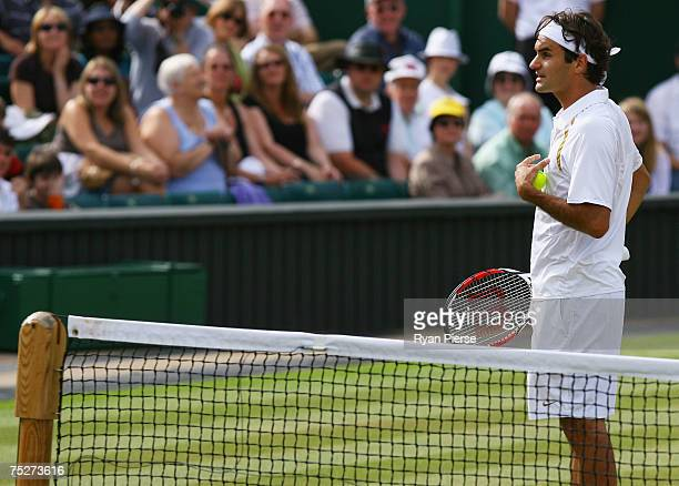 Roger Federer of Switzerland talks to the match umpire during the Men's Singles final match against Rafael Nadal of Spain during day thirteen of the...