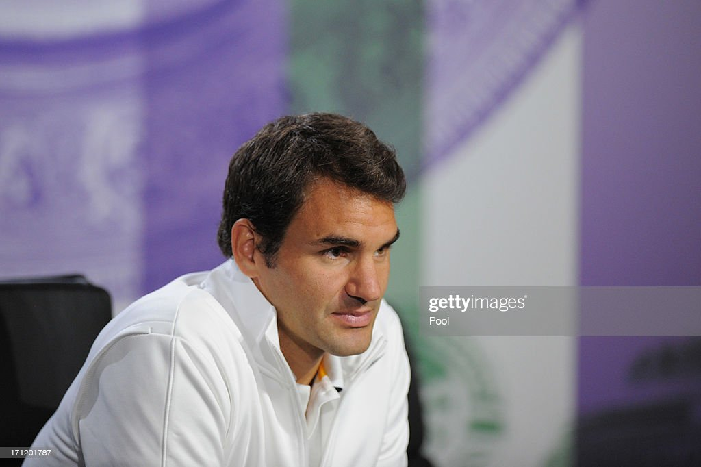 <a gi-track='captionPersonalityLinkClicked' href=/galleries/search?phrase=Roger+Federer&family=editorial&specificpeople=157480 ng-click='$event.stopPropagation()'>Roger Federer</a> of Switzerland talks to the media during previews for Wimbledon Championships at Wimbledon on June 23, 2013 in London, England.