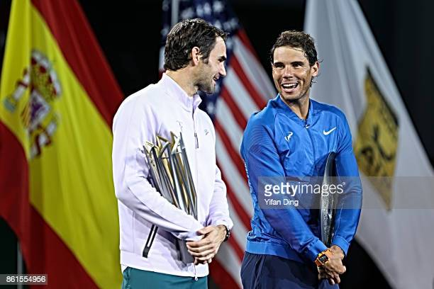 Roger Federer of Switzerland talks with his final opponent during the award ceremony after winning his Men's singles final match against Rafael Nadal...