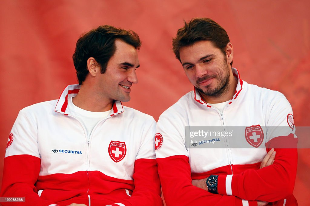 Roger Federer of Switzerland talks with Stanislas Wawrinka of Switzerland at the draw during previews for the Davis Cup Tennis Final between France...