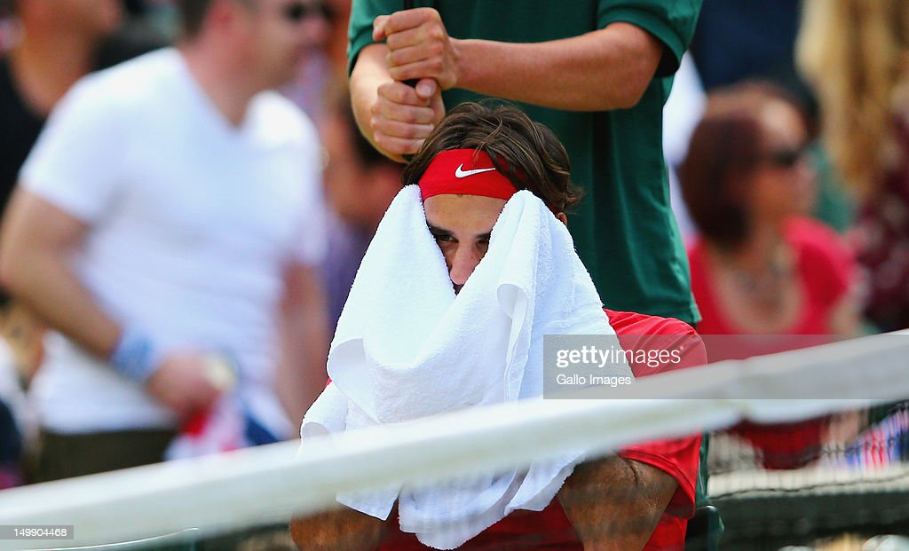 Roger Federer of Switzerland towels his face during the Men's Singles Tennis Gold Medal Match against Andy Murray of Great Britain on Day 9 of the London 2012 Olympic Games, at the All England Lawn Tennis and Croquet Club on August 5, 2012 in London, England.