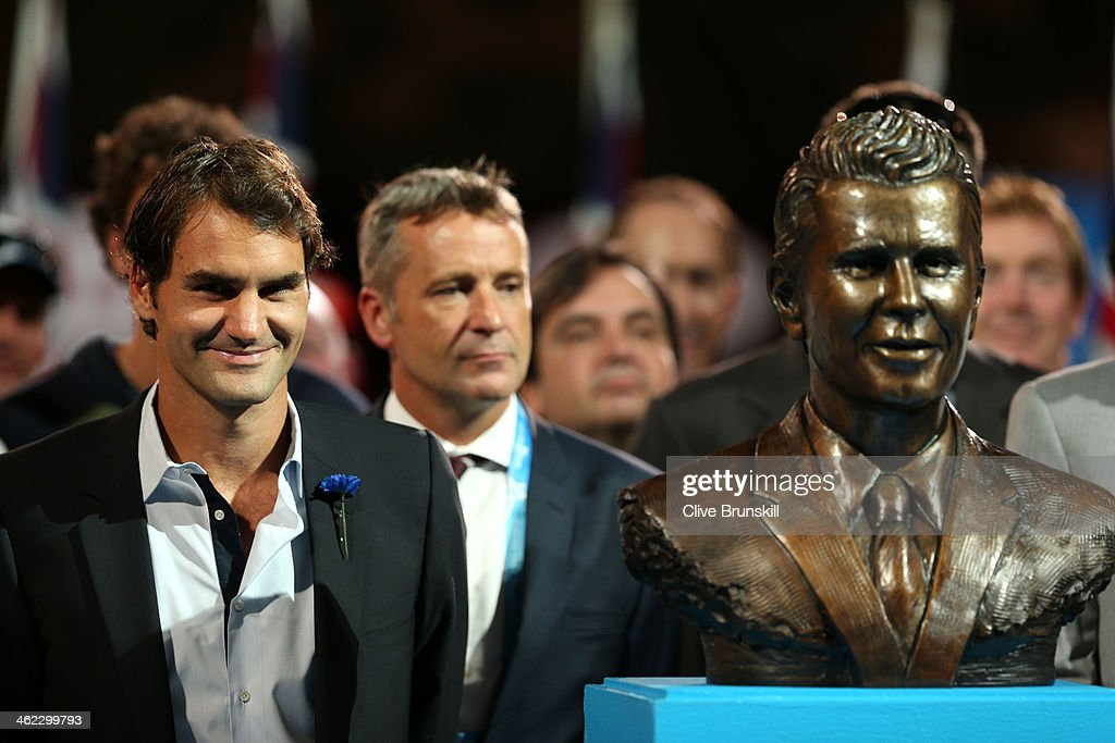 Roger Federer of Switzerland unveils a bust of Brad Drewett during day one of the 2014 Australian Open at Melbourne Park on January 13 2014 in...