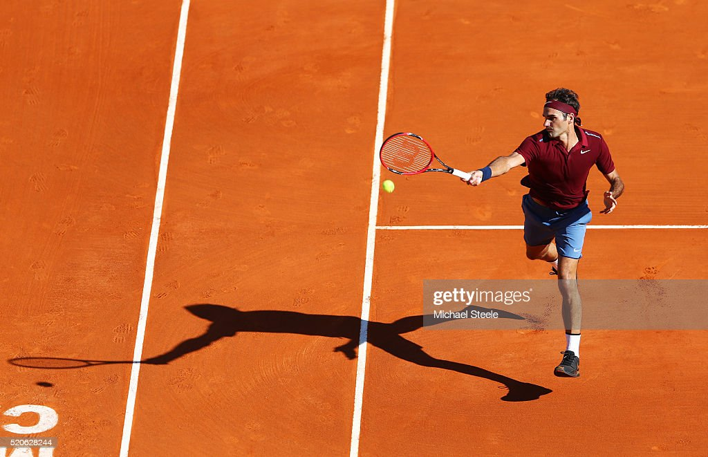 Roger Federer of Switzerland volleys during the second round match against Guillermo GarciaLopez of Spain on day three of the Monte Carlo Rolex...