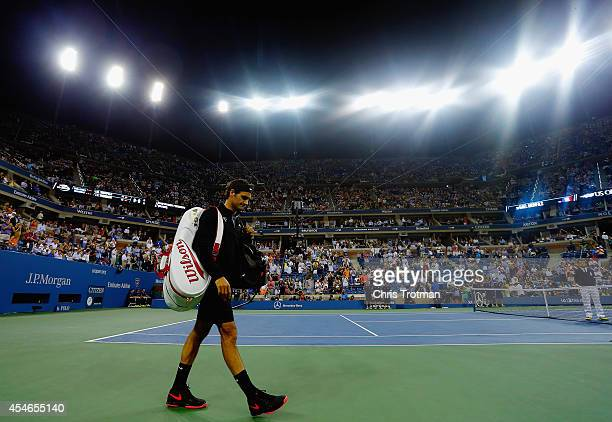 Roger Federer of Switzerland walks on to the court prior to his match against Gael Monfils of France in their men's singles quarterfinal match on Day...