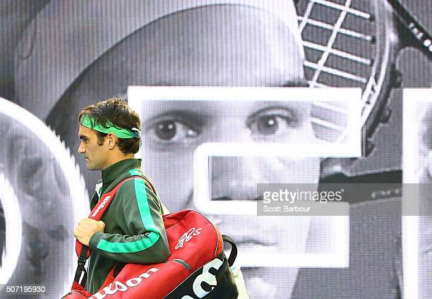 Roger Federer of Switzerland walks out on to court ahead of his semi final match against Novak Djokovic of Serbia during day 11 of the 2016...